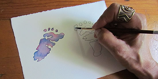 Customized watercolor baby footprints.